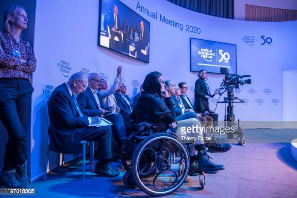 Participants including a woman on a wheelchair attend a panel at the 50th World Economic Forum in Davos