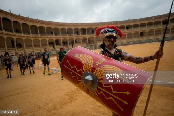 A participant dressed up as a Roman legionnaire takes part in the XXI 101km international crosscountry competition in Ronda on May 12 2018 About 8500...