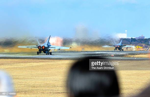 Participants including three Tokyo High Court judges investigate on the noise pollution around the Atsugi Air Base on January 8 2015 in Yamato...