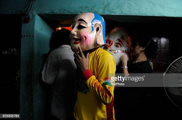 Participants inside a local shop in between their lion dance performance during the Chinese New Year celebration 2015 in Kolkata, India on February...