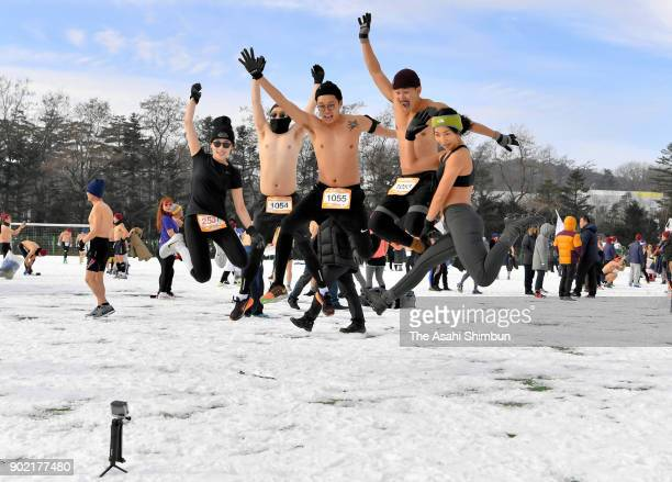 Participants jump for selfie photographs in minus six degrees Celsius prior to the mid winter marathon in pray for success of the PyeongChang...
