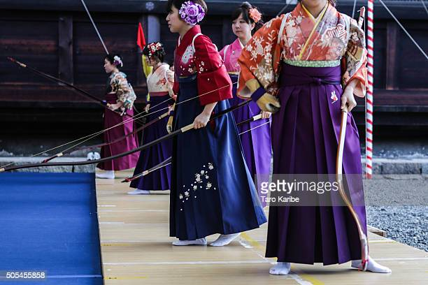Participants leave from the place, after shot arrows wearing 'Furisode,' a long sleeved kimono, take part in an archery event for 20-year-olds to...