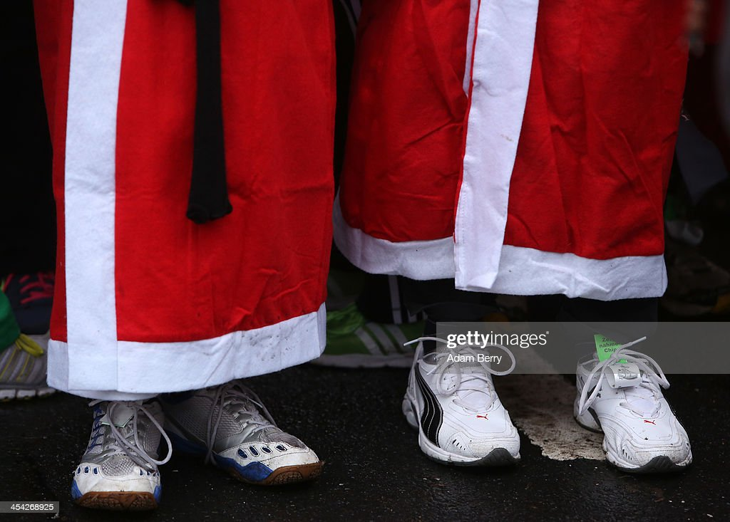 Participants line up to compete in the 5th annual Michendorf Santa Run (Michendorfer Nikolauslauf) on December 8, 2013 in Michendorf, Germany. Over 900 people took part in this year's races, which included one for children and one for adults.