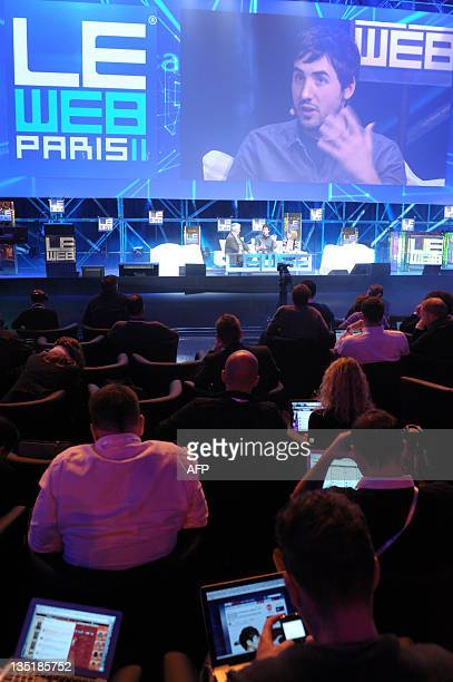 Participants listen to US Kevin Rose, co-founder and CEO of Milk network during a plenary session of LeWeb 11 event in Saint-Denis, suburbs of Paris,...
