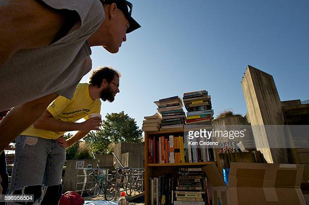 Participants look into donated books in their makeshift library while they take part in 'Occupy Baltimore' in Maryland October 7 2011 supporting the...