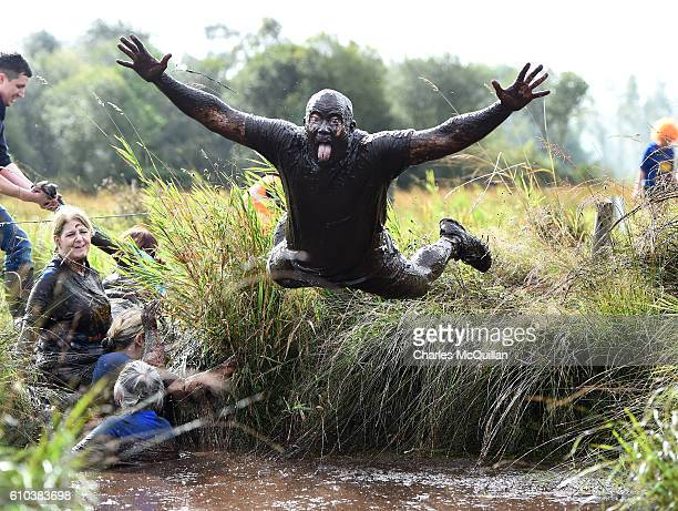 Participants make their way around the course during the Mud Madness event on September 25 2016 in Portadown Northern Ireland The charity run in aid...