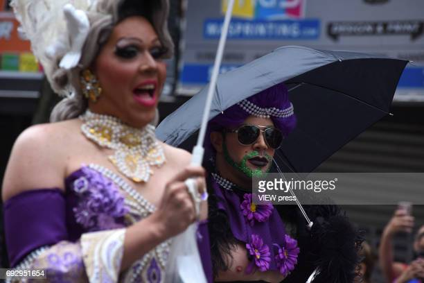 Participants make their way to the LGBT Queens Pride 2017 parade on June 4 2017 in New York