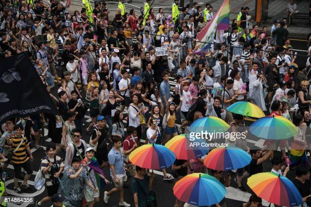 Participants march along a street during a 'Gay Pride' march in Seoul on July 15 2017 Thousands of people celebrated gay rights with song dance and a...