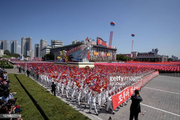 TOPSHOT Participants march during a mass rally on Kim Il Sung square in Pyongyang on September 9 2018 North Korea was marking the 70th anniversary of...