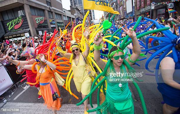 Participants march during the WorldPride 2014 Parade in Toronto Canada June 29 2014 WorldPride is an event that promotes lesbian gay bisexual and...