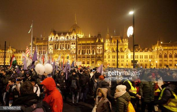 Participants march in Budapest downtown during a demonstration organized by nonparliamentary parties Momentum Movement and the 'Hungarian TwoTailed...