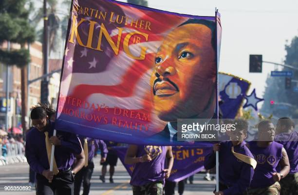 Participants march in the 33rd annual Kingdom Day Parade honoring Dr Martin Luther King Jr January 15 2018 in Los Angeles California The theme of...