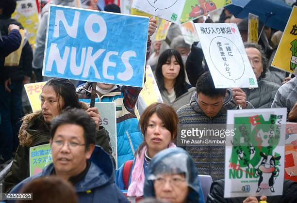 Participants march on during an anti-nuclear protest on March 10, 2013 in Osaka, Japan. On March 11, Japan is to commemorate second anniversary of...