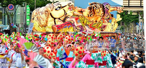 Participants march on with the 'Nebuta' floats during the Tohoku Rokkon Festival on June 25 2016 in Aomori Japan