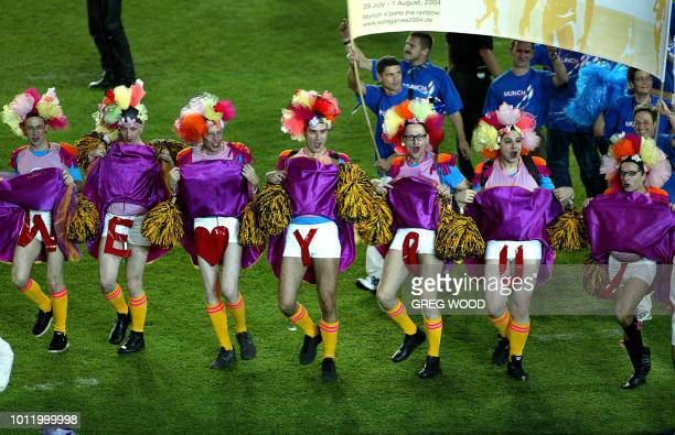 Participants march onto the field during the opening ceremony of the VI Gay Games in Sydney 02 November 2002 The Gay Games run until 09 November and...