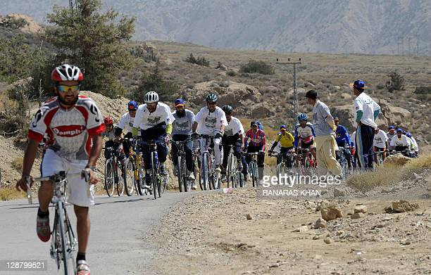 Participants of a bicycle rally ride through a mountainous area of Ziarat on October 9 2011 The rally was organised by the nongovernmental...