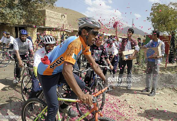 Participants of a bicycle rally ride through a village in the mountainous area of Ziarat on October 9 2011 The rally was organised by the...
