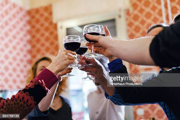 Participants of a cooking class having a toast