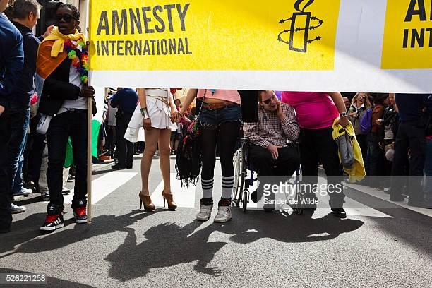 Participants of a gay pride parade in Brussels Amnesty International supporters