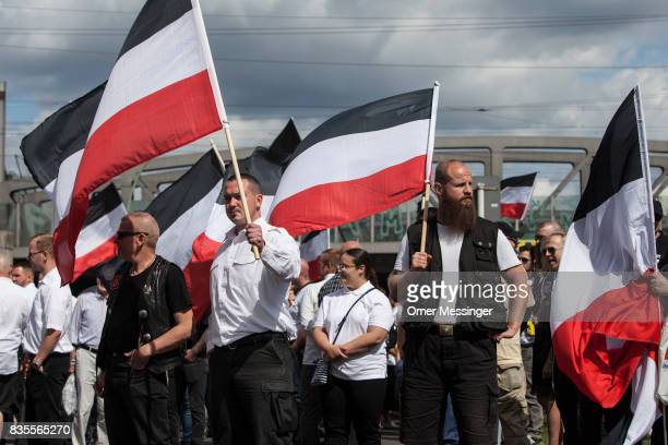Participants of a NeoNazi demonstration are seen holding nationalistic flags at a gathering point prior to an extreme right mass demonstration on...