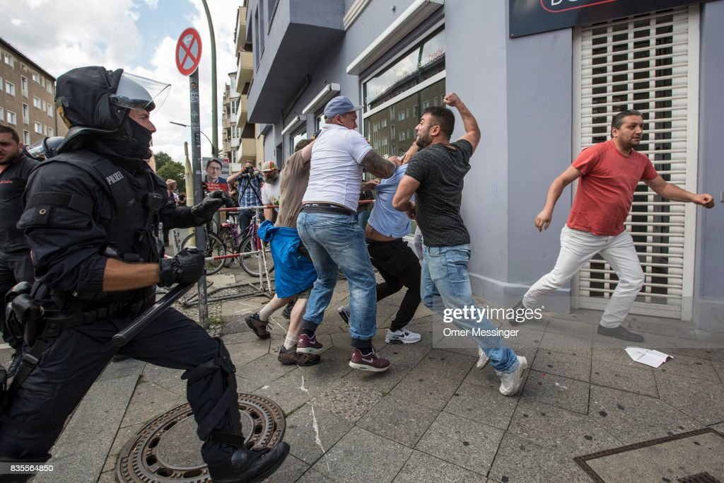 Participants of a Neo-Nazi march clash with counter demonstrators as German police try to break between the sides, on August 19, 2017 in Berlin, Germany. Some 1000 participants affiliated with Neo-Nazi and extreme right groups marched through the street of Berlin's Spandau district in commemoration of 30 years to Rudolf Hess's death. Hess committed suicide on August 17, 1987 at Spandau Prison and he also served as Adolf Hitler's deputy. The march attracted counter demonstrations along its route, organized by several left wing groups and political parties.