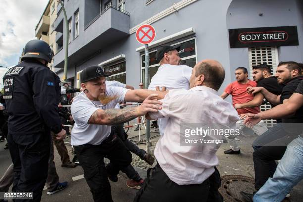 Participants of a NeoNazi march clash with counter demonstrators as German police try to break between the sides on August 19 2017 in Berlin Germany...