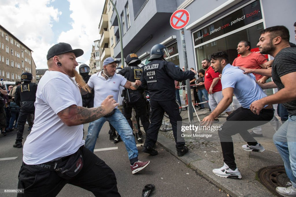 Participants of a Neo-Nazi march clash with counter demonstrators as German police try to break between the sides, on August 19, 2017 in Berlin, Germany. Some 1000 participants affiliated with Neo-Nazi and extreme right groups marched through the street of Berlin's Spandau district in commemoration of 30 years to Rudolf Hess's death. Hess committed suicide on August 17, 1987 at Spandau Prison and he also served as Adolf Hitler's deputy. The march attracted counter demonstrations along its route, organized by several left-wing groups and political parties.