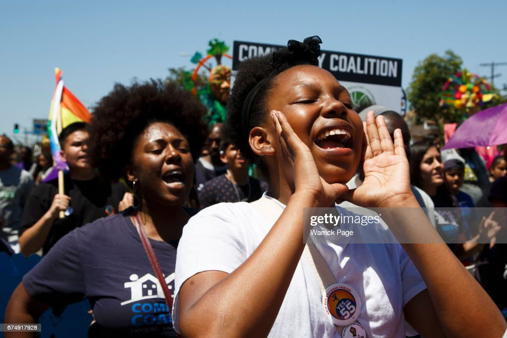 Participants of a peace rally, march through the streets, marking the 25th anniversary of the LA riots, on April 29, 2017 in Los Angeles, California. The riots were sparked by the police acquittals in the Rodney King beating.