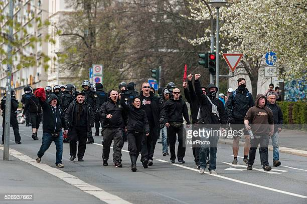 Participants of a rightwing extremist demonstration carrying placards promoting the socalled 'Third Way' march through Plauen Germany 01 May 2016...