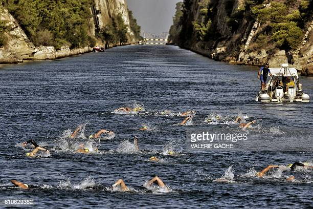 Participants of a 'swim accross the canal ' race swim through the 6346meter long Corinth canal near the city of Corinth on September 27 2016 The...