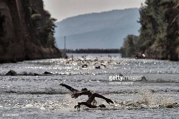 TOPSHOT Participants of a 'swim accross the canal ' race swim through the 6346meter long Corinth canal near the city of Corinth on September 27 2016...