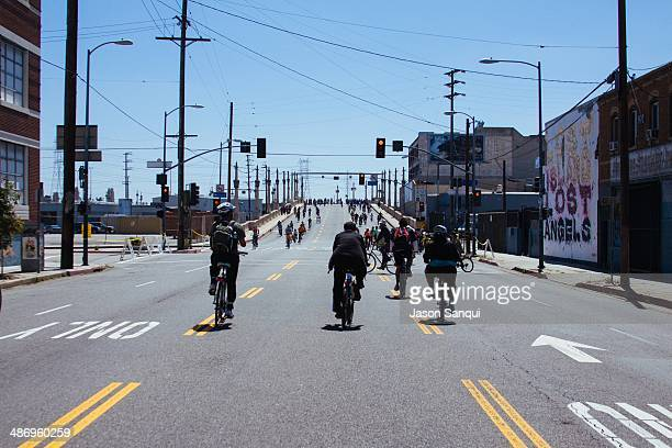 Participants of Ciclavia - a biannual event in cities across the US and Latin America promoting cycling as a way to improve air quality - cross the...