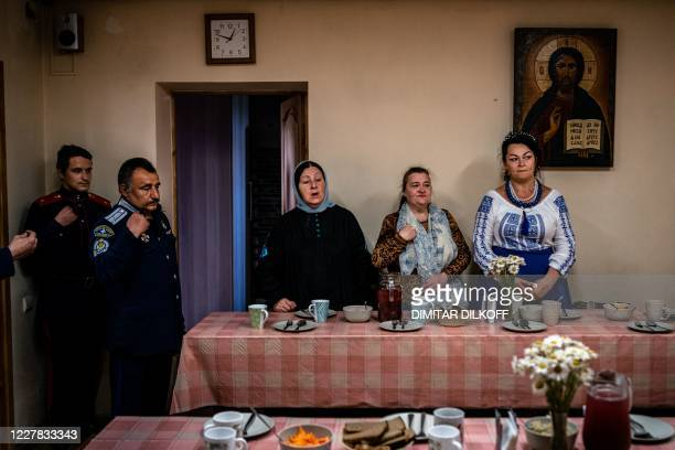 Participants of Cossack workshops pray before their lunch in a church dining room in the village of Alyaukhovo, some 60 kilometres east of Moscow, on...