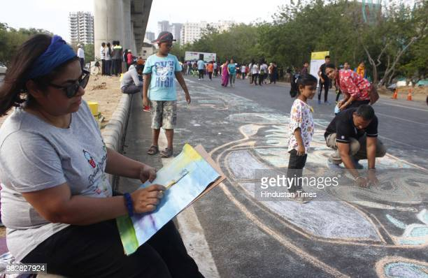 Participants of Raahgiri take part in painting open gym bhangra zumba and other events at Sector 55 56 Golf Course Road on June 24 2018 in Gurugram...
