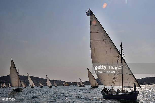 Participants of the 12th annual traditional Croatian wooden lateen sail boats regatta also named �gajetas� sail past the Croatian central Adriatic...