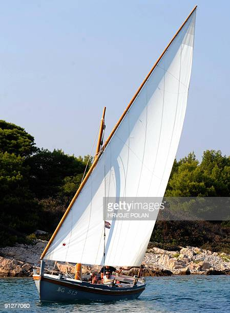 Participants of the 12th traditional Croatian wooden lateen sail boats regatta also named �gajetas� sail past the Croatian central Adriatic island of...
