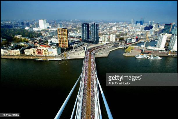 Participants of the 23 edition of the Rotterdam marathon pass the Erasmus bridge 13 April 2003 the Netherlands Kenyan William Kiplagat won the race...
