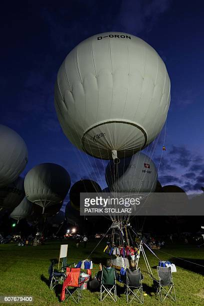 Participants of the 60th Coupe Aeronautique Gordon Bennett World Long Distance Gas Balloon Championship prepare their balloons for the competition in...