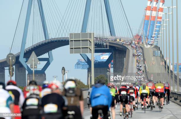 Participants of the amature race drive across Koehlbruecke bridge in Hamburg Germany 24 August 2014 About 22000 amateur cyclists competed in addition...