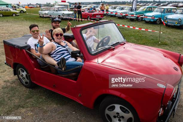 Participants of the annual meeting of the Trabant fans sit in a Trabant on August 24 2019 in Zwickau Germany The humble Trabant or Trabi as many...