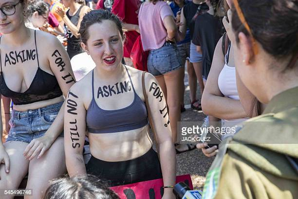 Participants of the annual 'SlutWalk' march through the Israeli Mediterranean coastal city of Tel Aviv on July 08 2016 to protest against rape...