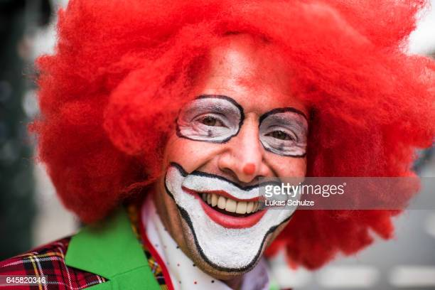 A participants of the carnival called 'Jeck' featuring a clown is waiting for the annual Rose Monday parade on February 27 2017 in Dusseldorf Germany...