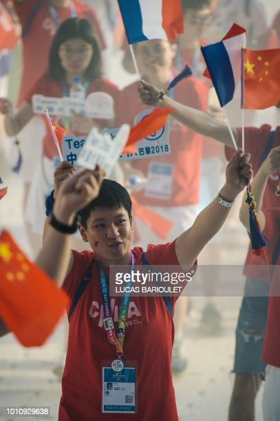 Participants of the Chinese team march onto the field during the opening ceremony of the 2018 Gay Games edition at the Jean Bouin Stadium in Paris on...