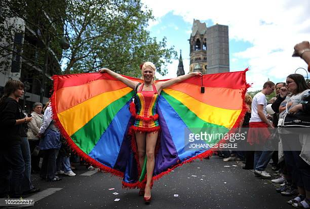 Participants of the Christopher Street Day gay pride parade celebrate in front of Berlin's Memorial Church in Berlin on June 19 2010 Gays and...