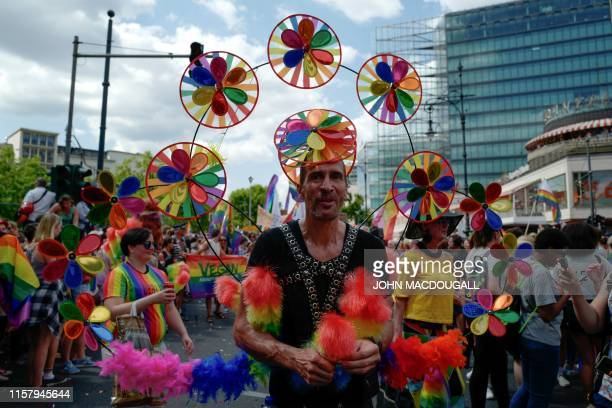 Participants of the Christopher Street Day gay pride parade walk through the streets of Berlin on July 27 2019 Gays and lesbians all around the World...
