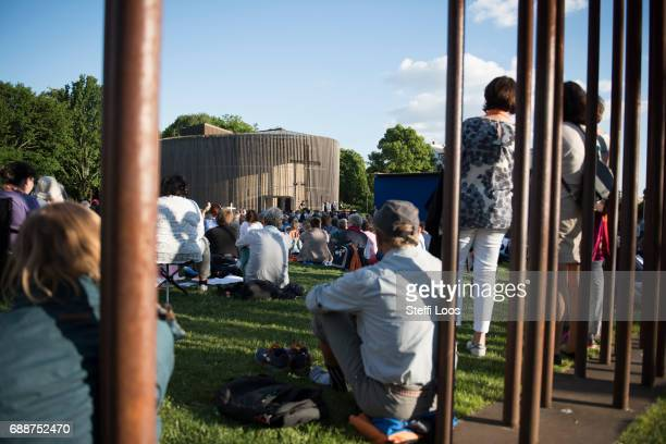 Participants of the Church Congress follow a communion service at the former location of the Berlin Wall's 'death strip' in front of the Chapel Of...