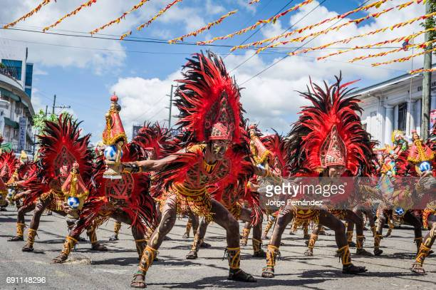 Participants of the dance contest dressed with beautiful colorful costumes during the celebration of Dinagyang in homage to The Santo Niño The...