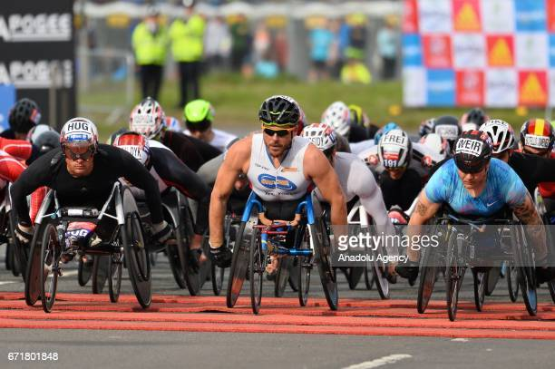Participants of the elite men's wheelchair race at the start of the Virgin Money London Marathon in London England on April 23 2017