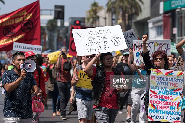 Participants of the Enough is Enough protest march along Hollywood Boulevard in Los Angeles California August 27 2016 People gathered to protest a...
