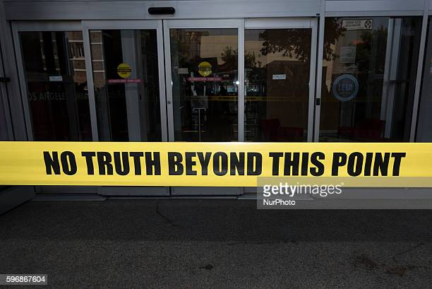 Participants of the Enough is Enough protest put yellow tape that reads No Truth Beyond This Point at the entrance to the CNN building in Los Angeles...
